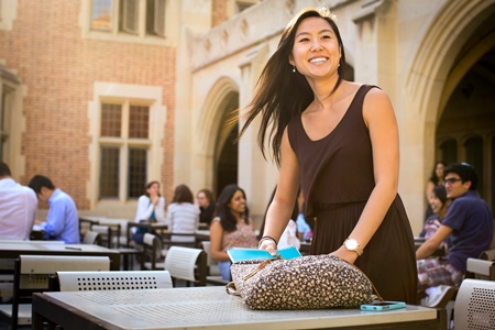 Student at table outside Kerkhoff Hall