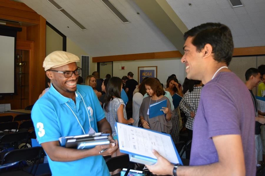 Two students laughing at New Student Orientation Program